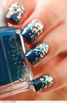 Beautiful and sparkly nail art. I usually don't like colors like blue, yellow, etc.... but this one is really pretty