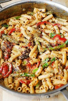 Pasta, Bell Peppers, and Asparagus in a Creamy Sun-Dried Tomato Sauce  - Delish.com