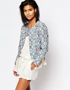 It's all in the details and details on this embroidered jacket are EVERYTHING.