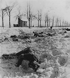 """Snow covered bodies of U.S. soldiers killed in the """"Malmedy Massacre."""" The soldiers, who had surrendered to the Germans, were shot to death. 80 were killed and 43 escaped. Charles Appman of the last living survivors of this little-known incident of WWII died on August 26, 2013 at the age of 94."""