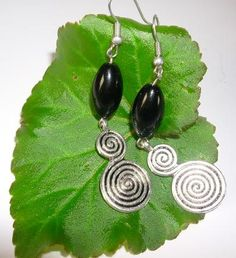 Black glass bead earring with antique silver swirl disc.$8.90
