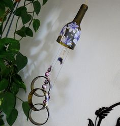 Wine bottle windchime, Dark Amber wind chime, Purple flowers, yard art, patio decor, recycled bottle wind chime, hand painted chime by LindasYardArt on Etsy