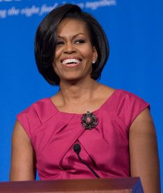 Michelle Obama wears a Talbots dress and Carolen Tanbaum brooch at the School Nutrition Association meeting