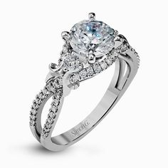 Delicately twisted brilliant white gold engagement ring from @simongjewelry