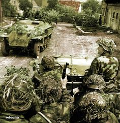 They must be Luftwaffe ground troops as they were the only ones to use true camo jackeks (not locally made non issue ones) , judging by the halftracks, Herman Goerring Panzer Divisioin, Russia or italy?...16