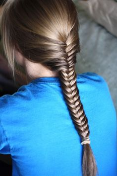 Fishtail Braid. Best tutorial I've seen. Includes a step that everyone else seems to miss; when you grab a new section of hair to add it gets added to the opposite side of the braid