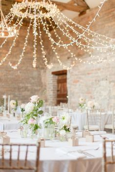 Gorgeous hanging string lights: http://www.stylemepretty.com/destination-weddings/2016/02/08/elegant-pastel-english-country-barn-wedding/ | Photography: Kerry Bartlett - http://www.kerrybartlett.co.uk/: