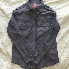 Gray Silk-Like button up Great oversized basic. In good condition with small snag in front as seen in last photo. Is usually styled it with sleeves rolled up. 10% polyester, but breathes great. Will steam before shipping. No trades. Eight Sixty Tops Button Down Shirts