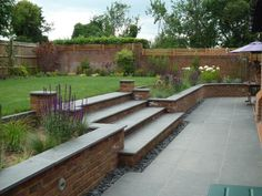 Garden designer Nancy Rodgers used our Sawn Black Basalt here to great effect, i. Garden designer Nancy Rodgers used our Sawn Black Basalt here to great effect, incorporating matching steps and copi Patio Steps, Garden Steps, Patio Ideas With Steps, Brick Garden, Garden Paving, Terrace Garden, Garden Walls, Walled Garden, Garden Design Pictures