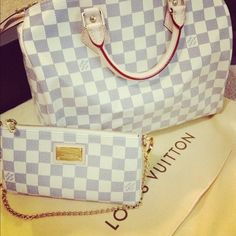 Checkered grey and white Louis Vuitton tote with matching clutch wallet.