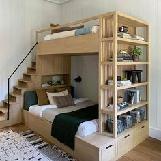 This bunk bed by Amber Lewis creates so much storage space! Created for her latest project, this bunk bed was combined with a bookshelf and drawers. Plus, unlike typical bunk beds, this one has a small set of stairs that lead to the upper level. Small Apartments, Bedroom Design, Home Room Design, Bed Design, Bed, Small Room Design, Home Decor, Bunk Bed Rooms, Room Design