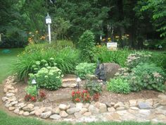 One of my gardens edged in river rock.