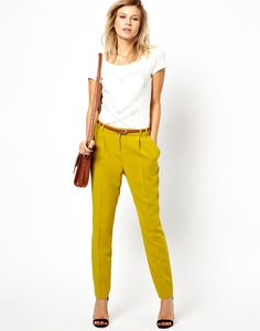 Pull out an unexpected hue like chartreuse -- paired with a simple white tee and black sandals.