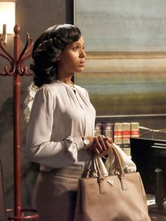 Washington's character Olivia Pope always always looks super-chic in her office-appropriate attire on the political drama. She's all about wearing neutrals and winter whites, as you can see in this scene. And we think no one on TV does it better. Courtesy of ABC -Cosmopolitan.com