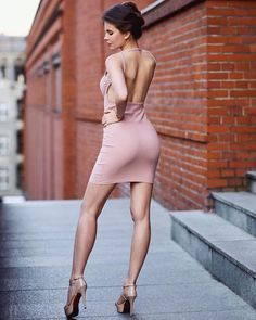 Ariadna Majewska is off the charts hot in a tight fitting, pink mini dress. As always, spectacular legs and ultra sky high stiletto heels! #hothighheelstightdresses