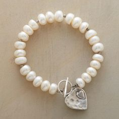 "LUV U BRACELET -- A heart-within-a-heart reaches out from the sterling silver toggle clasp on our bracelet of cultured freshwater pearls. A handcrafted exclusive. Approx. 7-1/4""L."