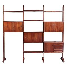 1960's Italian Bookshelf | From a unique collection of antique and modern shelves and wall cabinets at http://www.1stdibs.com/furniture/wall-decorations/shelves-wall-cabinets/