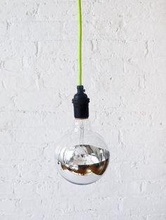 Neon Green/Yellow Pendant Light Cord w/ Giant Silver Globe Bulb. $95.00, via Etsy. Cord will be yellow and I will have a clear bulb - these will be suspended either side of the bed above the bedside tables