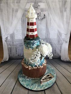 Maritim Wedding cake with lighthouse by Niciskleinebackwelt