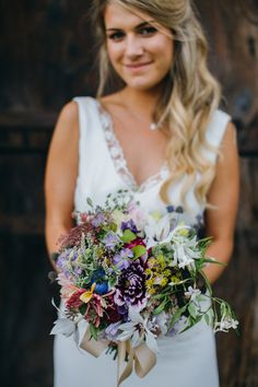 Honeysuckle, dahlias and jasmine in a late summer bouquet all grown, cut and tied by Hooting Ash Flowers. Image by Green Antlers Photography.