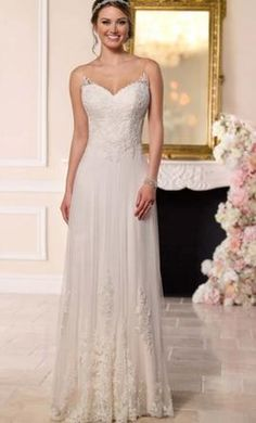 Stella York 6194 12: buy this dress for a fraction of the salon price on PreOwnedWeddingDresses.com