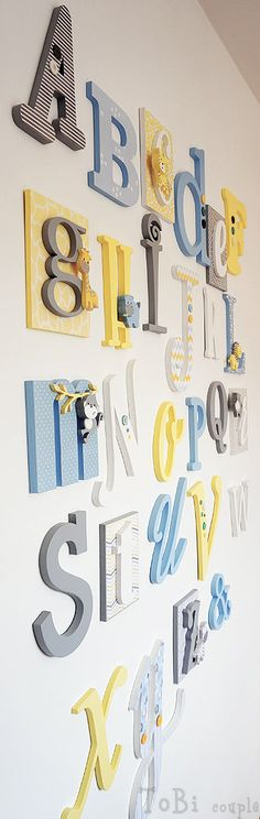 Each guest decorates a letter or two that will decorate the nursery.  We did this for Franny's shower and the letters go around the perimeter of the whole nursery...it looks great