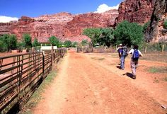 Hikers enter Supai Village (or Havasupai Village) in the Grand Canyon National Park, Arizona, USA. Havasupai Village is only accessible by foot, helicopter or horseback, and offers lodgings close to several waterfalls.