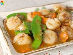 Easy recipe for stir-fry scallops, carrots and snow peas in XO Sauce.