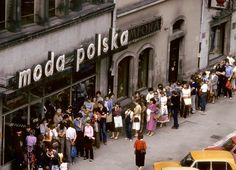 "Wroclaw, July 1982. The ""Moda Polska"" clothes shop in the Market Square. A long queue of people waits to be allowed in. This was a ""high end"" fashion store in those days, photo by Chris Niedenthal / Forum"