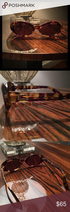 Gucci Sunglasses Authentic rare Gucci sunglasses. Comes with a case. Gucci Accessories Glasses