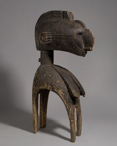 Africa | D'mba Headdress from the Baga people of Guinea coast | Wood | 19th-20th century | This headdress is nearly 4 foot/1.2 meters in height.  They often weigh up to 80 pounds/36 kgs. | The dancer, wearing a full raffia costume, carries the mask on his  shoulders, looking out through holes between the breasts.