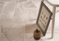The Diana Royal Tumbled Marble is a dense, tumbled, durable stone with creamy background tones and beige veining.