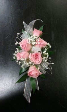 Pink sweetheart roses Senate with baby's breath the silver Bling Corsage