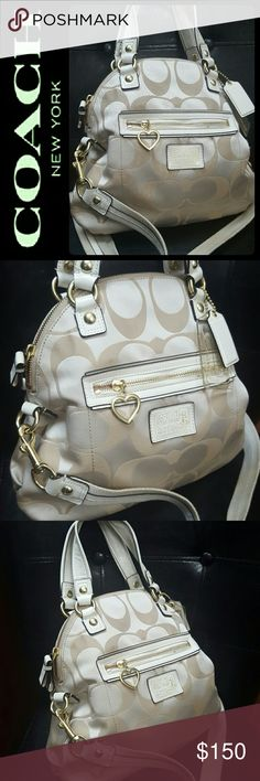 Coach Canvas Satchel Crossbody Bag Coach Signature Bag in Gorgeous Poppy Collection Line! Handcrafted from the Finest Materials with Its Superior Craftmanship Reflects Commitment to Enduring Quality! Comes in Tan Beige Shade with Adjustable Crossbody Strap! Also Removable Strap if Using as Satchel!  Top Zipper Closure Opens to Fully Lined Interior with Zipped and Slip Pockets! Faint Gold Tone Hardware with Double Handles! Tonal Stitching Throughout! Used with Signs of Minimal Wear, Overall…