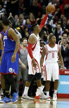 Houston Rockets center Dwight Howard (12) raises up the ball as the buzzer went off as the Rockets win 88-87 over the Philadelphia 76ers during an NBA basketball game at Toyota Center, Friday, Nov. 14, 2014, in Houston. ( Karen Warren / Houston Chronicle )