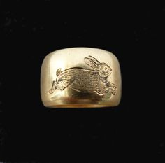 Old Heavy 18 Carat Band Engraved With A Running Rabbit Part of my new collection of animals engraved onto old bands, so far comprising rabbits, foxes and snakes. This old band is Hallmarked London 1971 size 5 - 5.5 weight - 12.2g band 11.14mm wide FREE WORLDWIDE SHIPPING