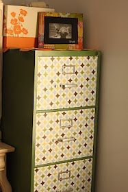 Dress up a metal file cabinet with paint and contact paper!!