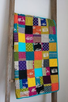 Craftyblossom: hipster baby quilt. This could be one way to do away with my Echino fabric stash!
