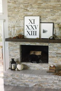 accents on stone pinecone, black lantern and white art contrast