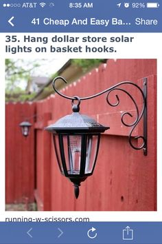 Basket hooks and dollar store solar lights to hang on your outdoor fence
