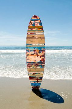 i'd hang surf board up like a picture, or make a table out of it. very cool.