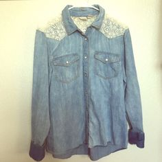 Long sleeve jean shirt This is a jean shirt bought at kohls, it has a lace type material that you can see in the photo. You can roll the sleeves or you can also leave them down and button them. In great condition! Mudd Tops Button Down Shirts
