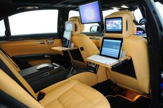 Mercedes S Class filled with Apple innovation! The back of the seats have ipad workstations and there is a mac mini hooked to a display that comes down from the ceiling!