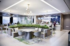 M Moser Associates was tasked with the office design for investment company Fosun, located in Shanghai, China. Fosun wanted to transition from being a Lobby Interior, Office Interior Design, Office Interiors, Office Designs, Office Ideas, Office Canteen, Cozy Cafe, Banquette Seating, Workplace Design