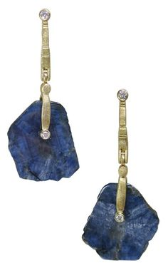 "These one of a kind earrings are from the Alex Sepkus ""Sticks & Stones"" collection. Crafted of 18K gold, they show the beauty and magic of the 25.37 ctw Blue Sapphire Crystal Slices, with the added sparkle of .17 ctw in Diamonds (F-G/VVS)."