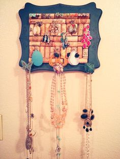 Handmade jewelry holder from wine corks. Stamped the outer edges for added detail and chose eclectic knobs for design feature and to hold necklaces,