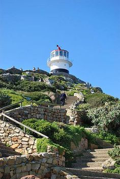 Do not hesitate to climb the stairs to the lighthouse. It rally offers a stunning view on the Atlantic Ocean which make you want to travel again! Boulder Beach, Atlantic Ocean, Stunning View, Lighthouses, Cape Town, Bouldering, Rally, Scenery, Stairs