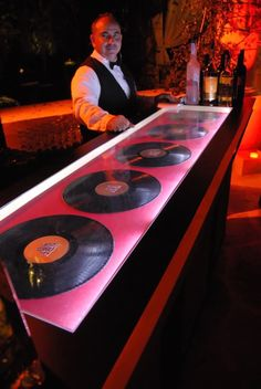 Motown theme event - the custom bar had an illuminated shadowbox inset with Motown record detail.