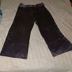 VICTORIAS SECRET CARGO PANTS SATINY SMOOTH CARGO PANTS IN 100% SILKY POLYESTER,  BUTTON FLY CLOSURE, BELT LOOPS WITH MATCHING SASH, SIZE MEDIUM,  IS PURPLISH/GRAY IN COLOR,  WITH 4 CARGO POCKETS, 2 ON EACH LEG.  NO RIPS,  TEARS OR STAINS. Victoria's Secret Pants Straight Leg