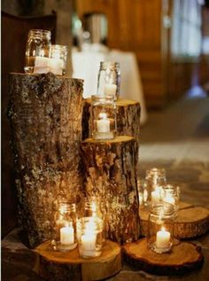 Tree stumps different heights but with mason jars and flowers - We have plenty of logs laying around. Maybe in the corners of the tents